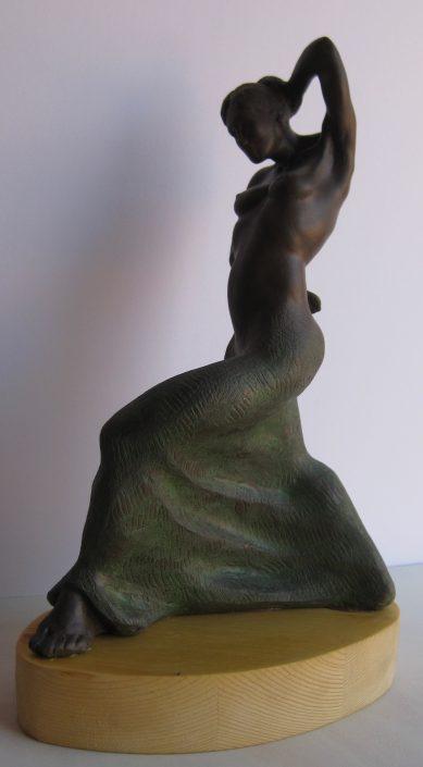 Terracuita de fang negre i pàtina verda (32x22x12).